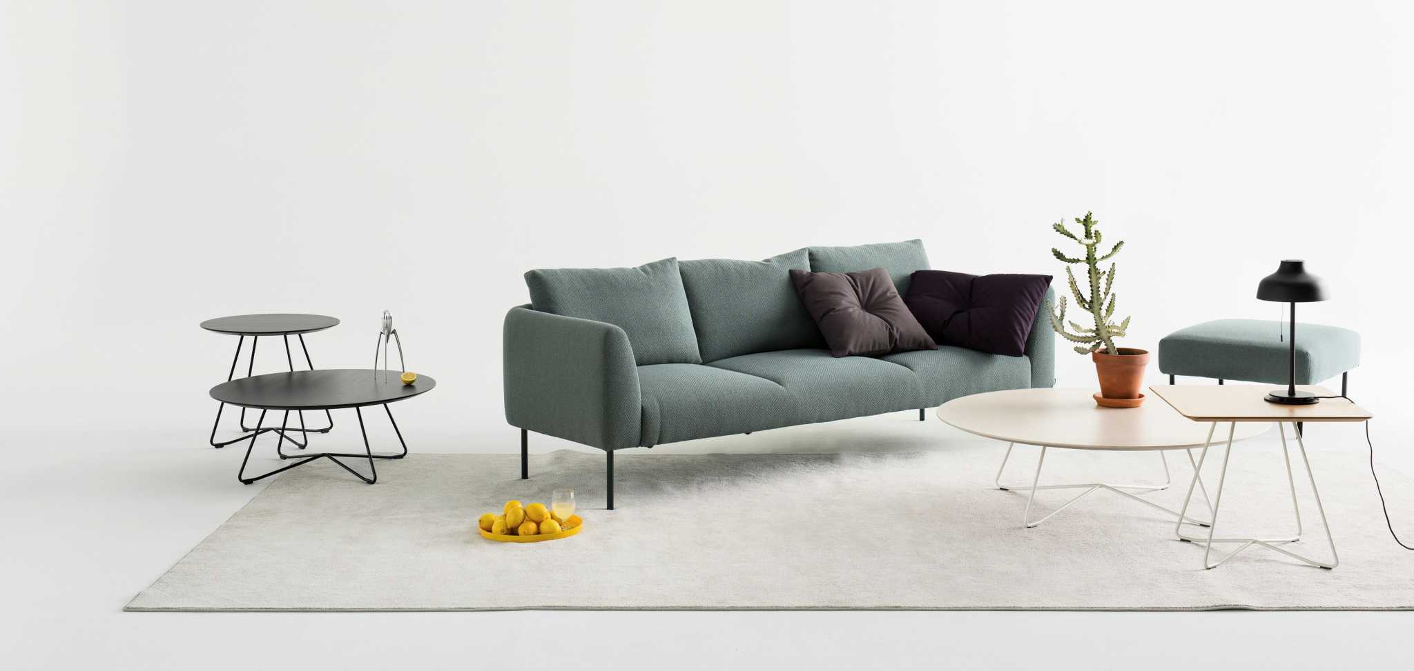 Large grey sofa with a sofa table