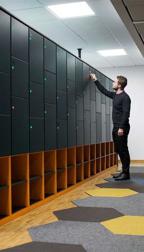 Man using Martela Dynamic Storage at Cybercom's office in Stockholm