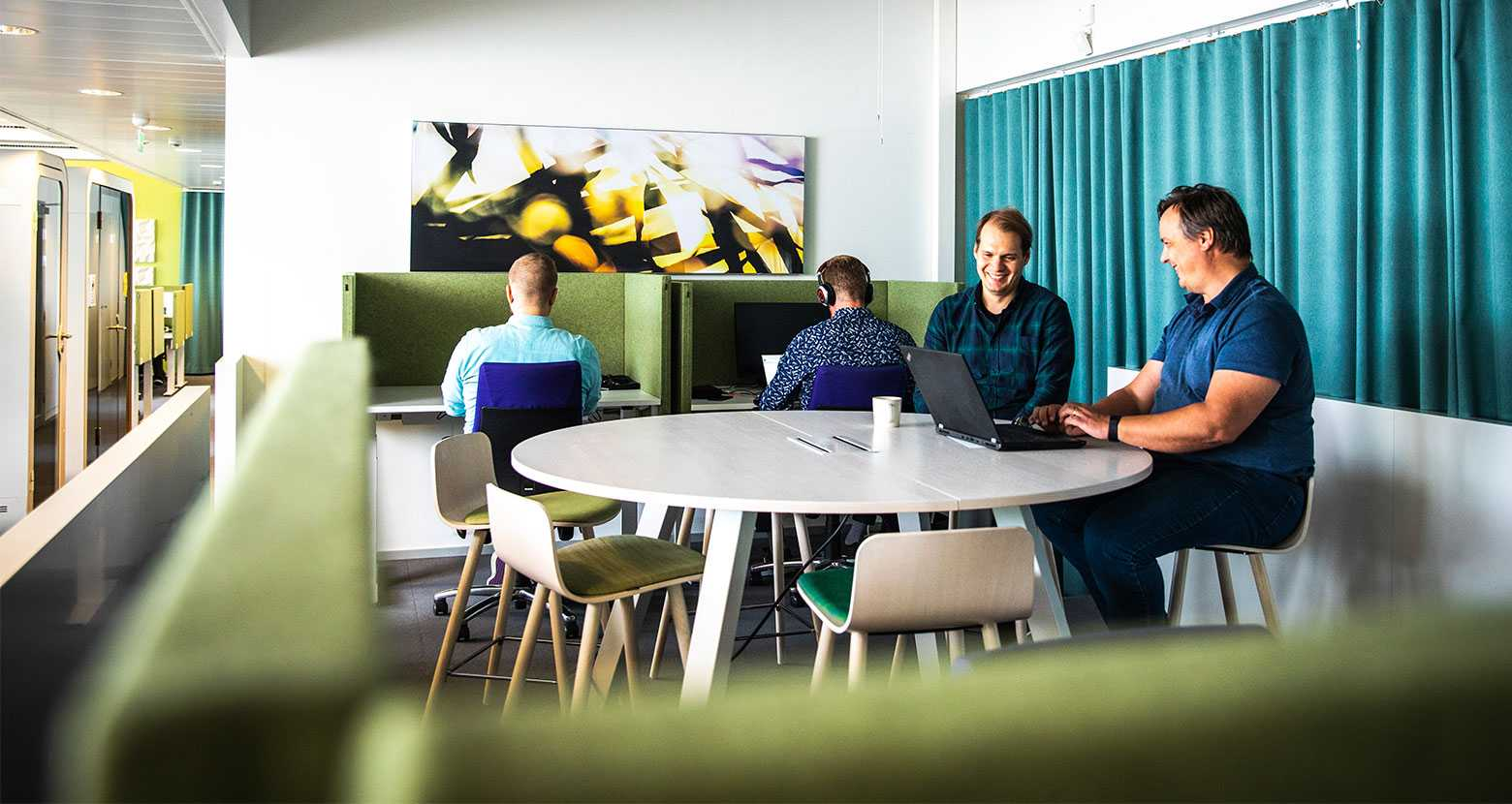 Martela's Sola chairs, Frankie table and Face screens at Enfo's office in Espoo, Finland