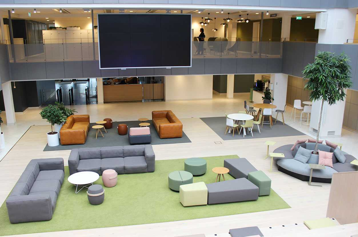 Martela's Diagonal Play and Movie benches and Scoop tables at EVRY's head office in Solna, Stockholm