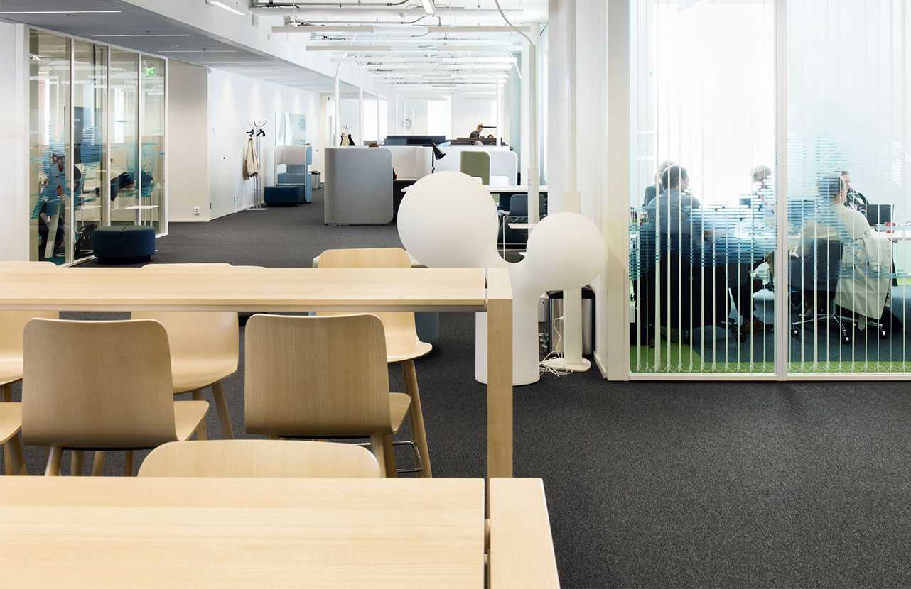 Martela's wooden Sola chairs at Solteq's office in Vantaa, Finland