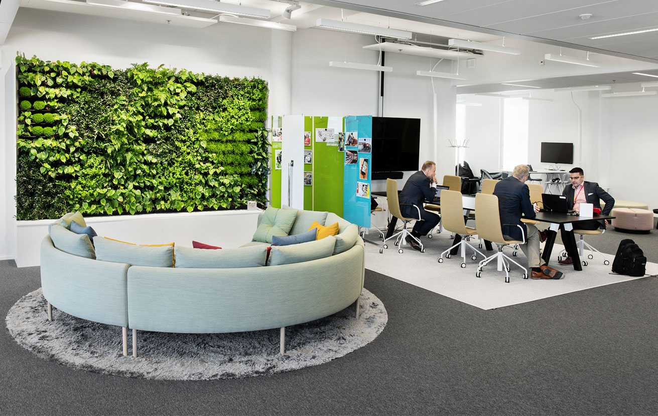 Martela's Nooa sofa, Sola chairs and Frankie table at Solteq's office in Vantaa, Finland