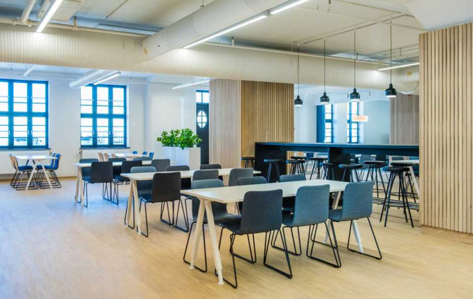 Martela's Sola chairs and Alku tables in Havnelageret's canteen in Oslo