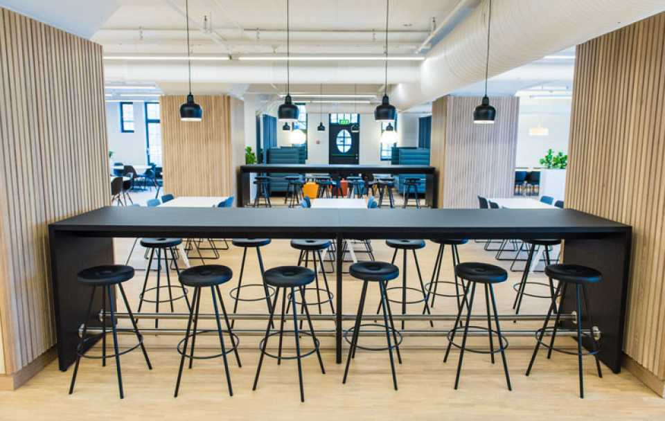 Martela's Chat tables and Drop stools at Havnelageret's canteen in Oslo