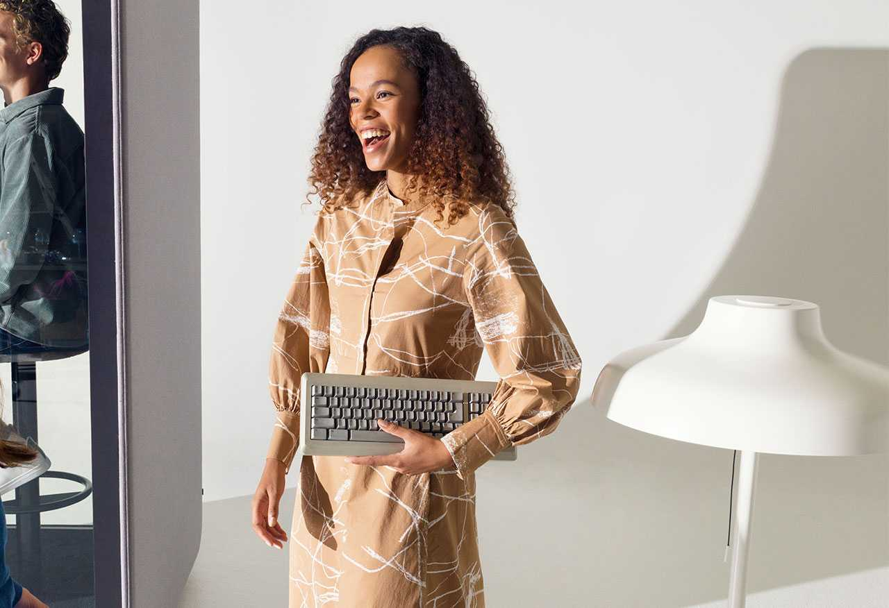 A woman carrying a keyboard