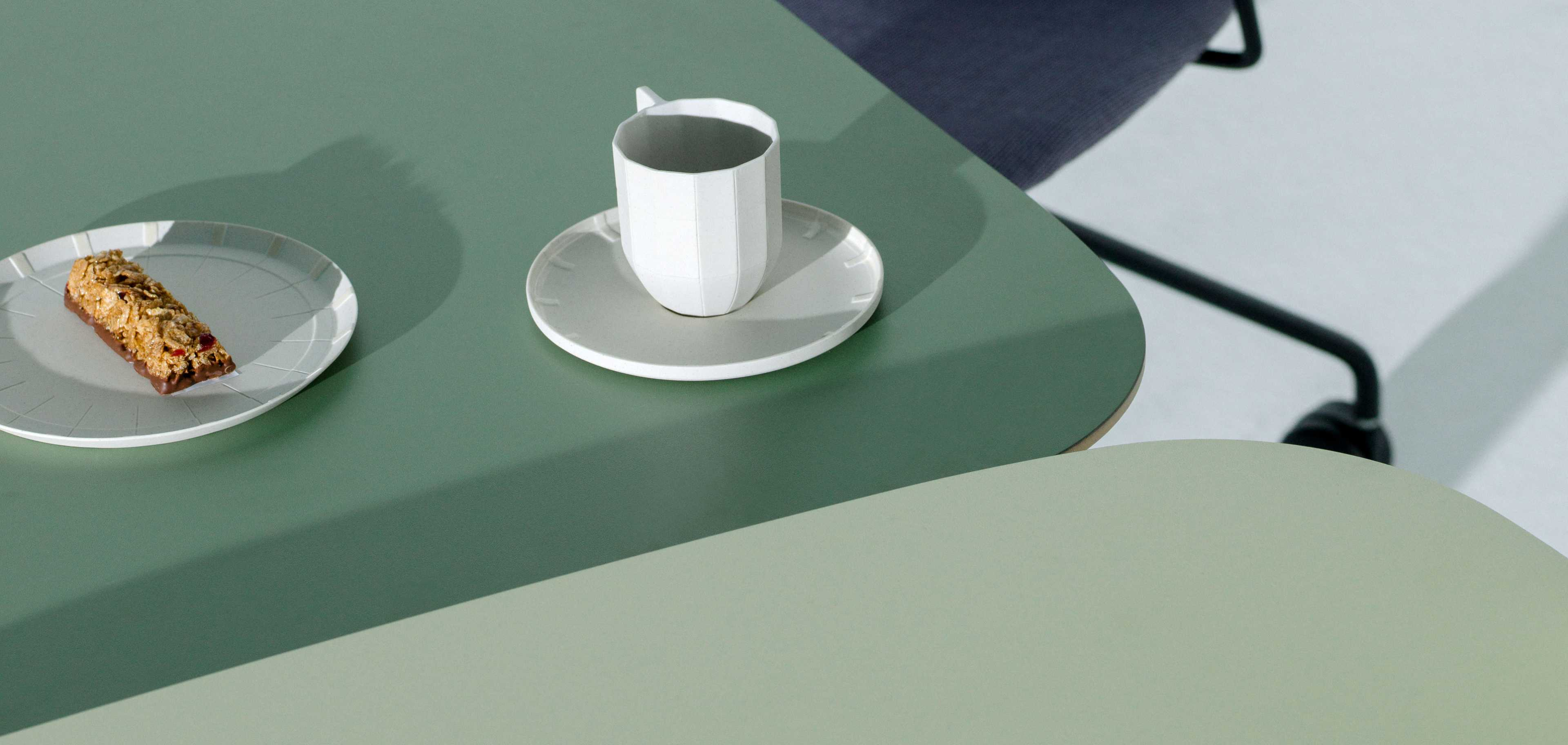 Green desks with coffee