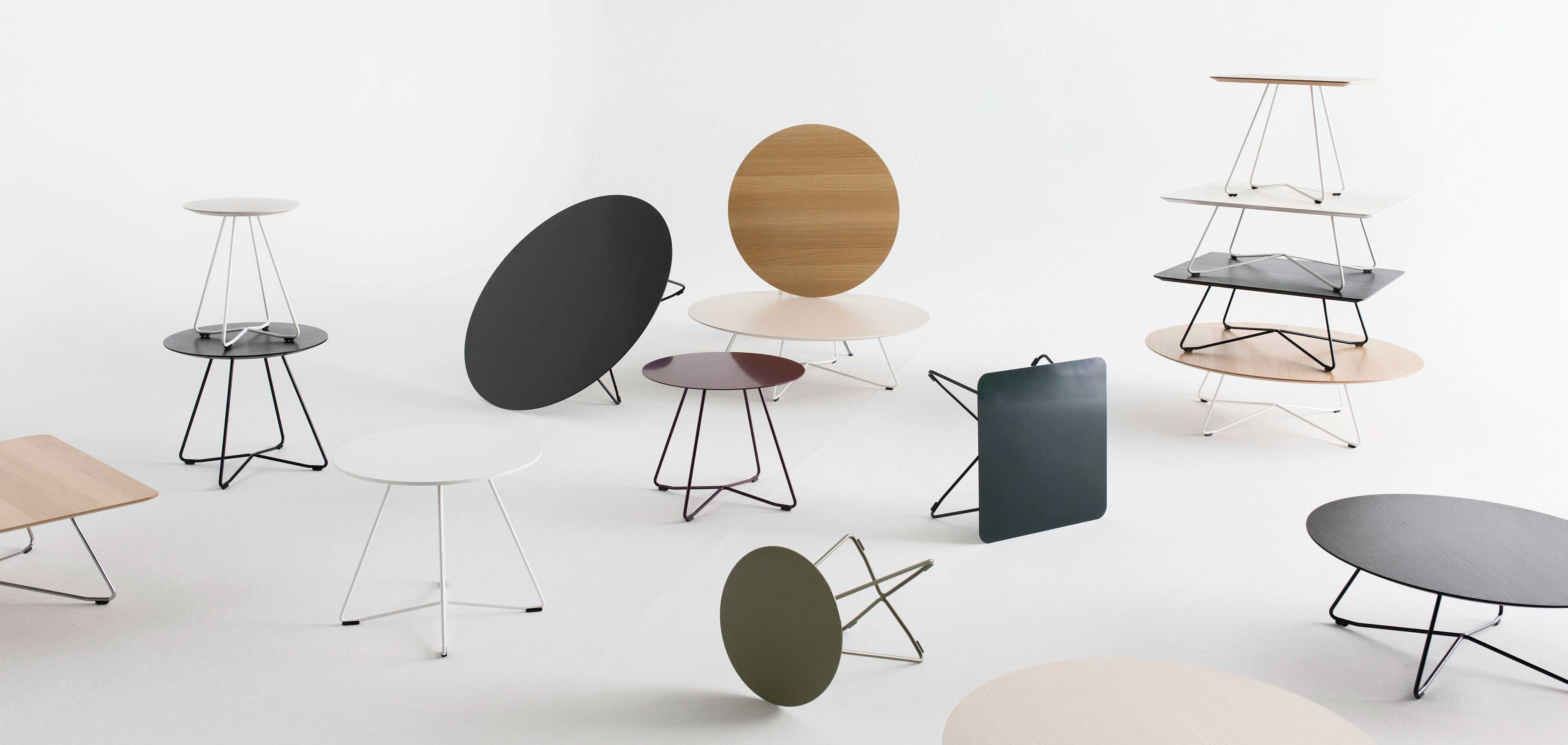 Scoop tables by Martela