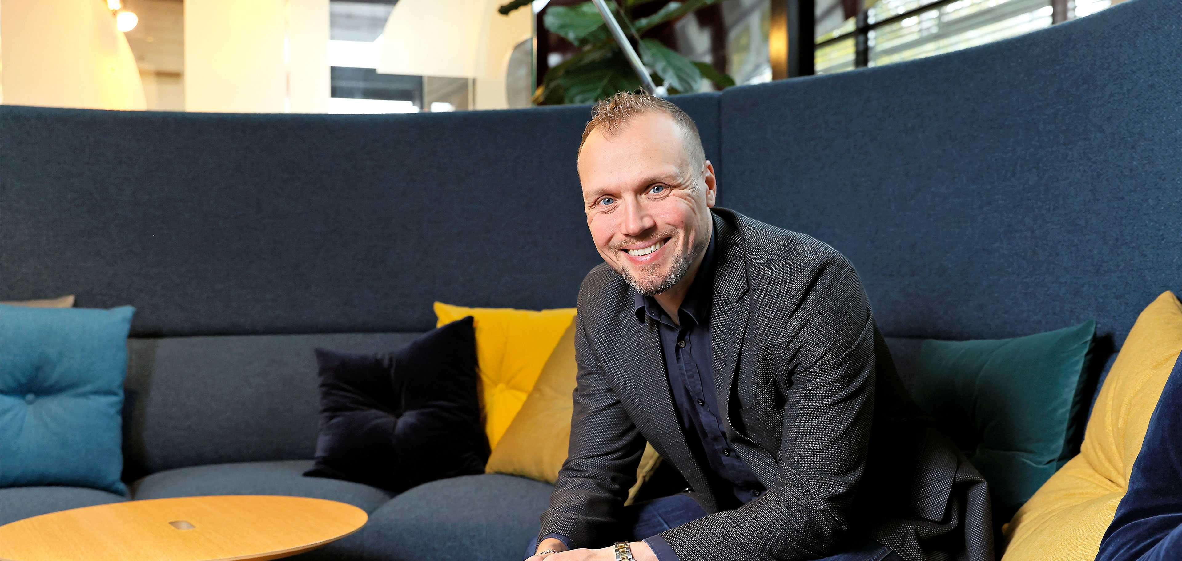 Martela's CEO Artti Aurasmaa sitting on a sofa