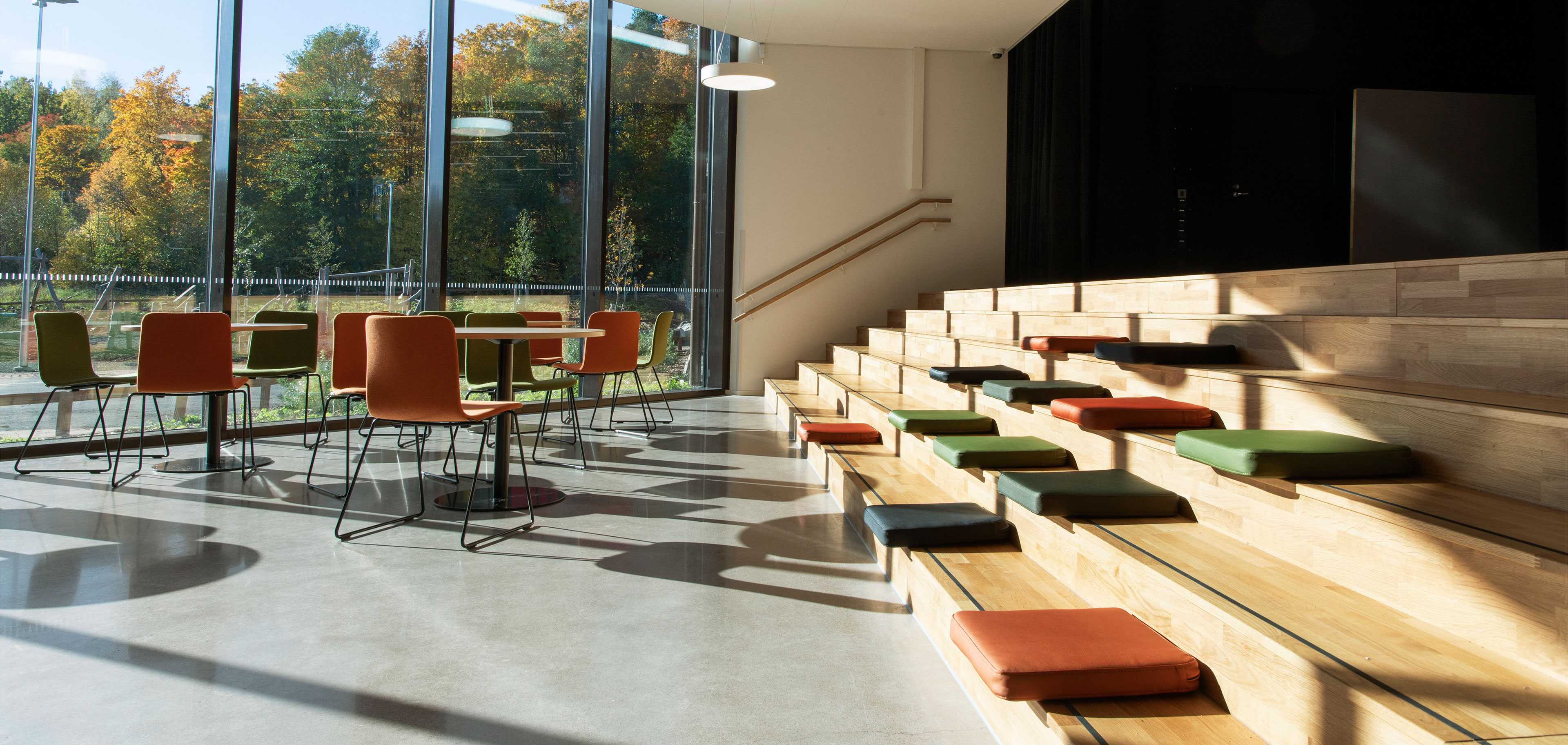 Martela's Sola chairs, Spot tables and Puffet seat cushions at Syvälahti Community Centre in Turku, Finland
