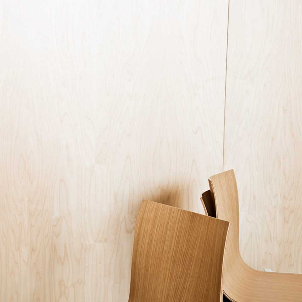 Wooden chairs on a wooden background