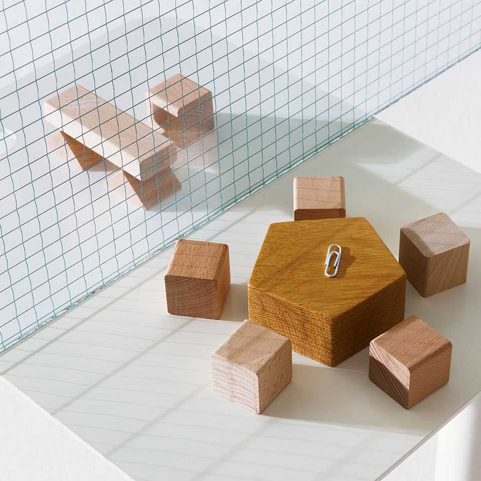 Wooden blocks composed as groups of tables